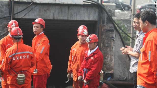 Rescuers prepare to enter a coal pit to rescue trapped workers in Hengtai coal mine on August 24, 2011 in Qitaihe, China.