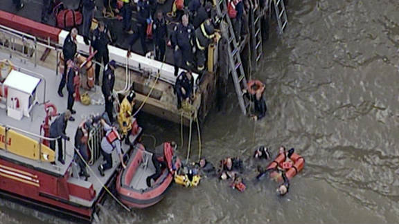 Rescuers pull people out of New York's East River after a helicopter crash on October 4.
