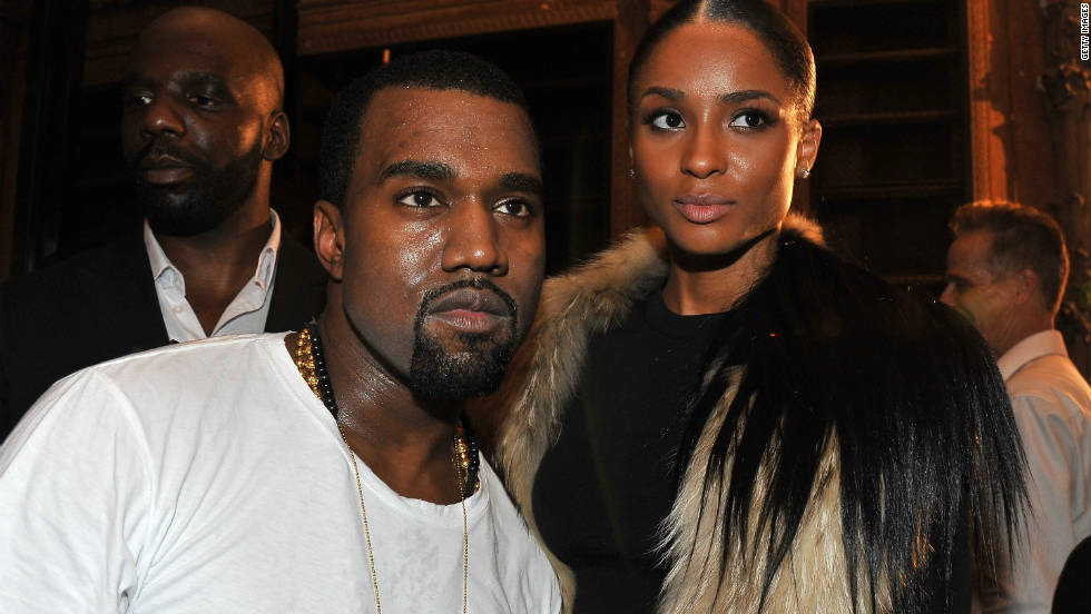 Hip hop artists Kanye West and Ciara attend the Dw by Kanye West Ready-to-Wear Spring/-Summer 2012 show.