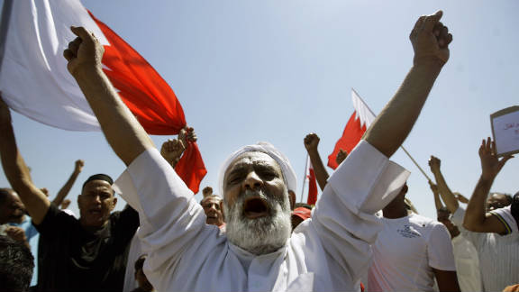 Bahraini Shiite mourners chant slogans during the funeral of a man killed during anti-government demonstrators in March.
