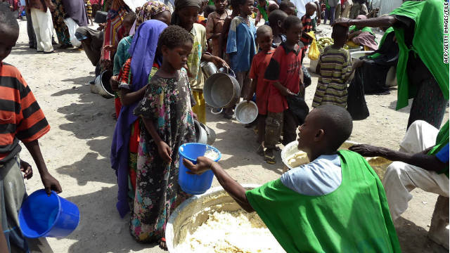Children receiving food at a WFP-feeding centre in Somalia's capital Mogadishu in September.