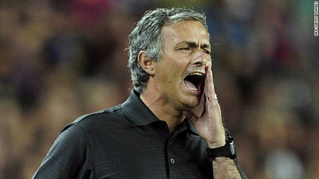 Real Madrid coach Jose Mourinho shouts during the second leg of the Spanish Super Cup at Barcelona's Camp Nou.