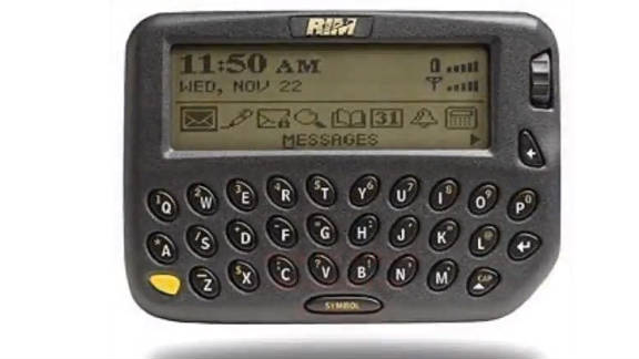 """The first BlackBerry phone was released by RIM Corporation in 1999. The phone was unusual at the time in that it had a full keyboard, could access e-mail and was used as a personal planner. It was the beginning of the always-connected era, prompting PC World in 2005 to name it the 15th greatest gadget of the past 50 years. It's now known as a """"CrackBerry"""" by corporate executives across the world for its addictive qualities."""