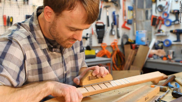 Dr. Withrow uses tight precision while working on a guitar neck.