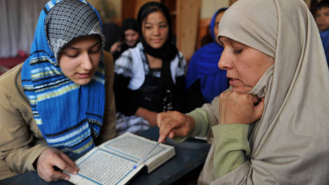 Meher Afroza, right, teaches the Quran last month at an Islamic school in Kabul, Afghanistan.