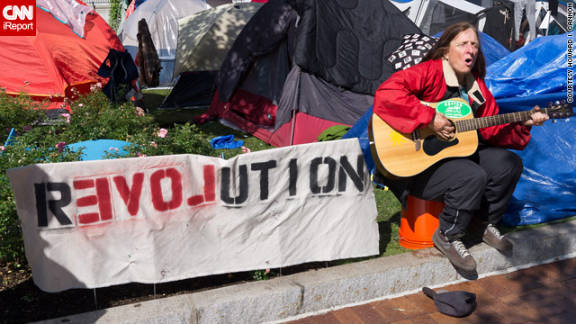 "CNN iReporter Howard I. Cannon, a computer scientist from Boston, took this photo. ""The crowd seemed very orderly and the tone was nonviolent and educational. There were clearly 'hippie' types in a range of ages but also some ex-businesspeople and some who looked homeless. They mostly seem to want government money to flow to the disadvantaged and displaced rather than to the big banks and corporations,"" he said. ""The general sense I get is that they want change in the status quo, that this group can peacefully catalyze change, and for that change to help the underclasses."""