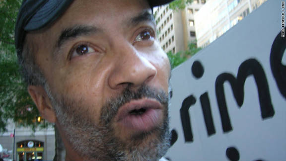 "A 50-year-old man, calling himself ""Jesus"" (""for today"") is unemployed and homeless. He says he's ""protesting against the crooks on Wall Street, the lack of prosecution of the Wall Street criminals. The American government is afraid to prosecute Wall Street tycoons, and they have stolen trillions of dollars from the American people. ... I'm living on the fringe. I feel like it's my civic duty to come down here."""