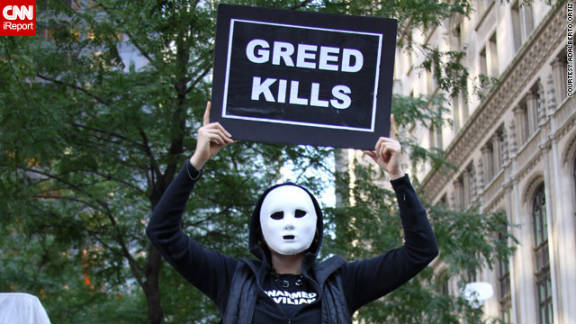 "CNN iReporter Aldaberto Ortiz, a former New York schoolteacher who is unemployed and living in Union City, New Jersey, took this picture: ""The protesters were demanding debt relief, equal salaries for all, holding the banks accountable for the economical difficulties the people and the country were facing."" he said. ""There were students, war veterans, Black Bloc anarchists, hippies, punks, professionals, feminists, even tea party supporters. It was a mix representing different subcultures and political groups."""