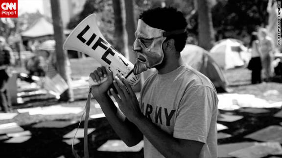 "CNN iReporter Raffe Lazarian, a photographer from Burbank, California, took this picture. ""The protest seemed to begin as a show of solidarity for all of the NYC protesters. The majority of people were speaking (out) against corporate bailouts, the Iraq war and the Fed,"" he said. ""For the most part I agree, maybe not with all of the specific issues, but the overall movement is a just and noble cause."""
