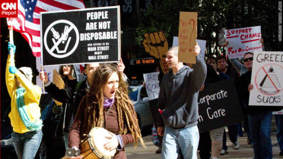 "CNN iReporter Trisha Janik, an Internet sales coordinator from Chicago, took this photo: ""Being a Saturday, the area was unusually quiet as I walking down Madison Street. Out of seemingly nowhere, I heard chanting and saw a crowd making its way toward me,"" she said. ""There were chants of 'Occupy Chi!' and 'We are the 99 percent!' """