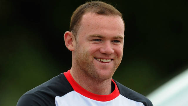 Wayne Rooney is all smiles in England training despite his father's arrest as part of a betting fraud probe.