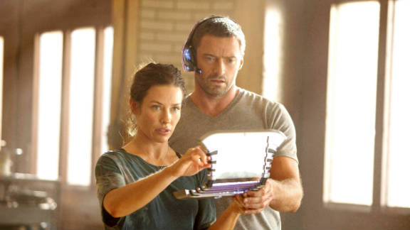 """Hugh Jackman stars as Charlie Kenton and Evangeline Lilly stars as Bailey Tallet in """"Real Steel."""""""