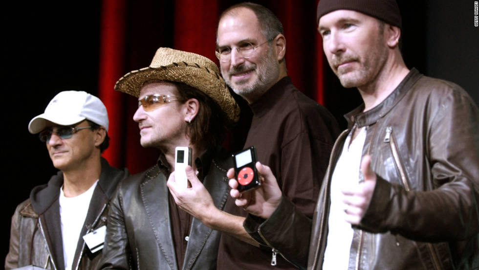 "<a href=""http://www.cnn.com/specials/tech/steve-jobs-the-man-in-the-machine"">Jobs</a> laughs with Jimmy Iovine, from left, Bono and The Edge of U2 at a celebration of the release of new iPod products in October 2004 in San Jose, California."