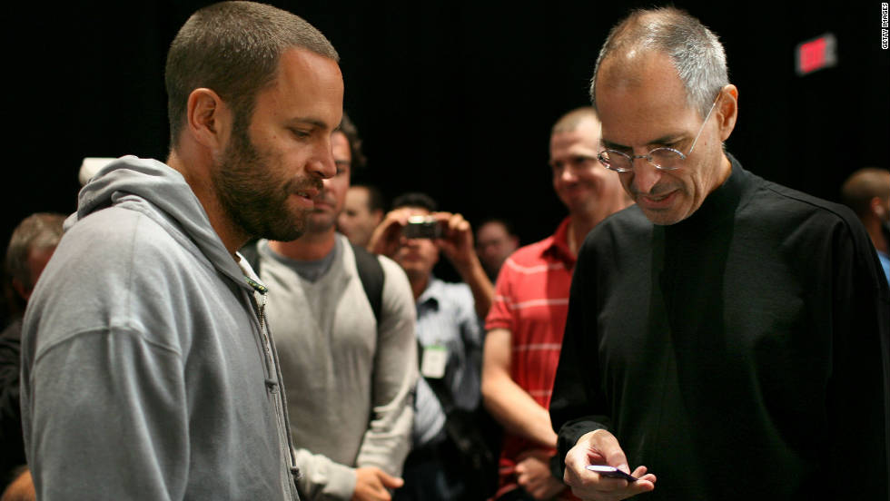 "Musician Jack Johnson, left, talks with <a href=""http://www.cnn.com/specials/tech/steve-jobs-the-man-in-the-machine"">Jobs</a> during an Apple special event in 2008 where a new version of the iPod Nano and Touch were announced."