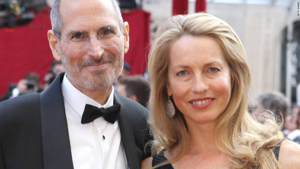 "<a href=""http://www.cnn.com/specials/tech/steve-jobs-the-man-in-the-machine"">Jobs</a> poses with his wife, Laurene Powell, at the 2010 Academy Awards."