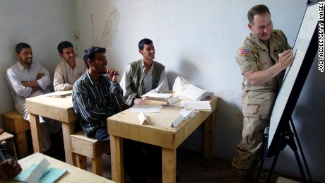 United States army Lt. Col. Ed Dorman from Cookville teaches his first English class in a school near the Bagram Air Base in Afghanistan, April 2002.