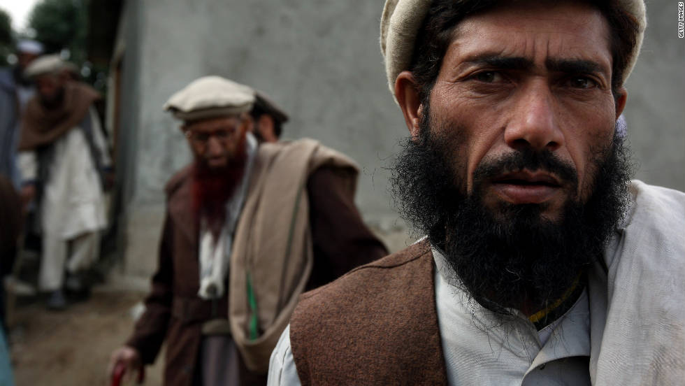 Afghan elders of the Korengal Valley arrive for a meeting with U.S. and Afghan military officials on October 30, 2008, in eastern Afghanistan. The officials tried to convince them to accept a new paved road through the valley as part of a large American development project. The elders refused.