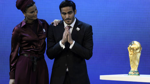"The winning bids for the 2018 and 2022 World Cup finals are announced. Russia wins the bid to host the 2018 tournament. But the big shock came when Blatter announced that Qatar would host the 2022 finals, despite FIFA's bid inspection report stating that hosting the World Cup in June and July would be ""considered as a potential health risk for players, officials, the FIFA family and spectators, and requires precautions to be taken."""