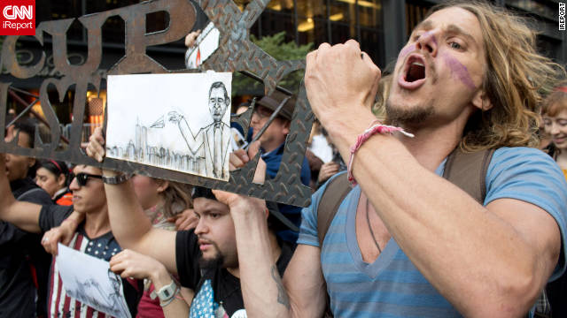 Demonstrators carry metal Occupy Wall Street sign this week in Downtown Manhattan