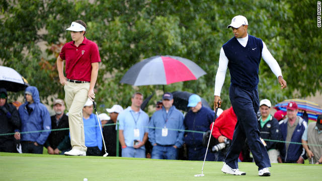 Contrasting fortunes: Tiger Woods (right) was in awful form, while Patrick Cantlay played an impressive opening round.