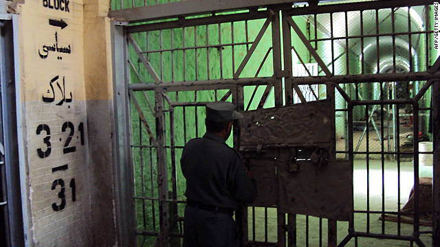 An Afghan policeman stands guard inside Kandahar jail on April 27, 2011