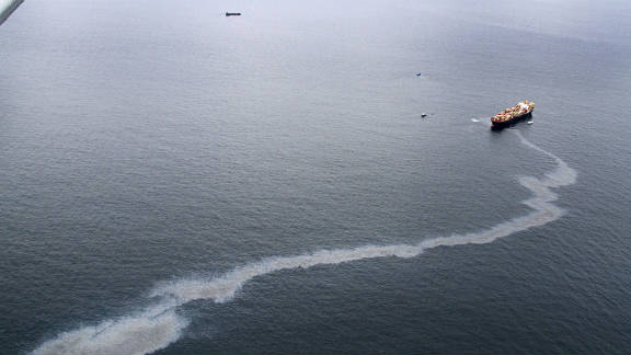 An oil slick is seen coming from the Rena on October 9.