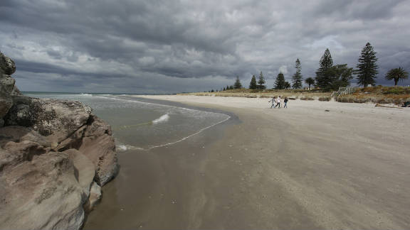 In a worst-case scenario, Mount Manganui beach would be coated with oil. Oil clumps have already washed ashore there.