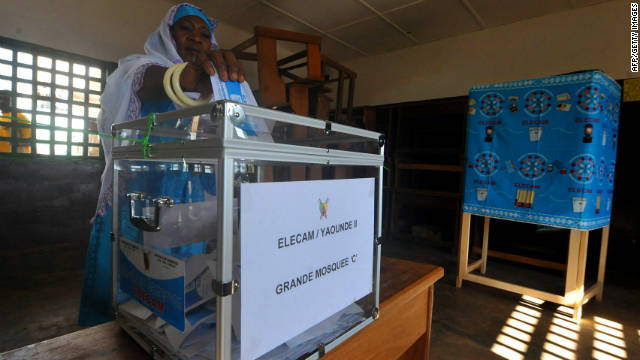 A Cameroonian casts her vote at a polling station in Yaounde on October 9.