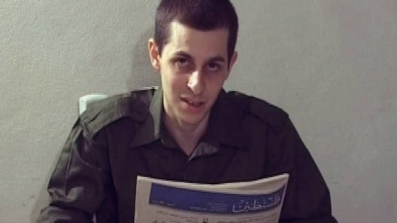 In a Hamas video, Israeli soldier Gilad Shalit is seen holding a Palestinian newspaper.
