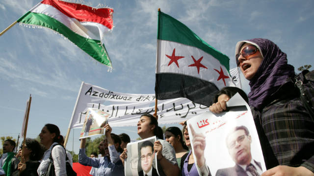 Kurdish protestors hold pictures of Meshaal Tamo at a demonstation in Arbil, northern Iraq, on October 8, 2011.