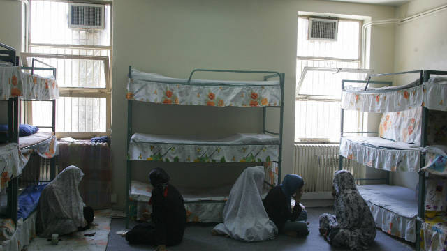 Iranian women inmates sit at their cell in Evin jail, north of Tehran, 13 June 2006.