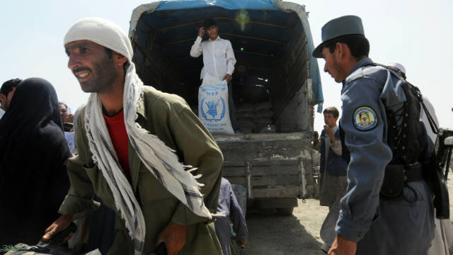 Aid workers from the World Food Programme (WFP) distribute food in Kabul on August 25, 2008.