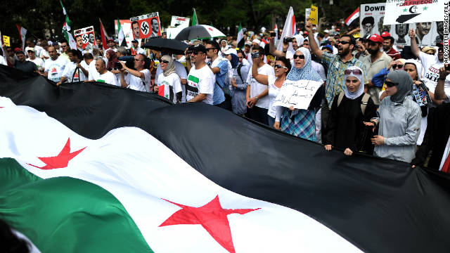 Protesters shout slogans during a demonstration against the Syrian government in front of the White House in July.
