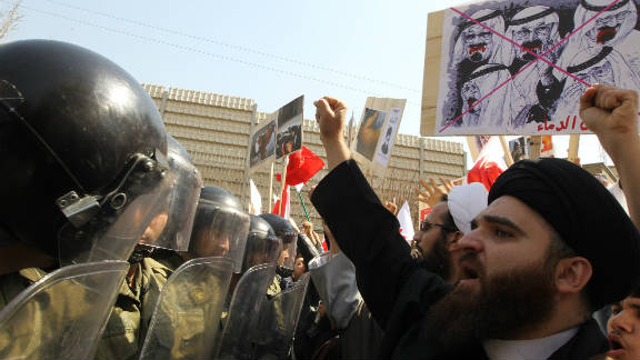 Iranian clerics hold up anti-Saudi placards as they face riot policemen in front of the Saudi embassy in Tehran earlier this year.