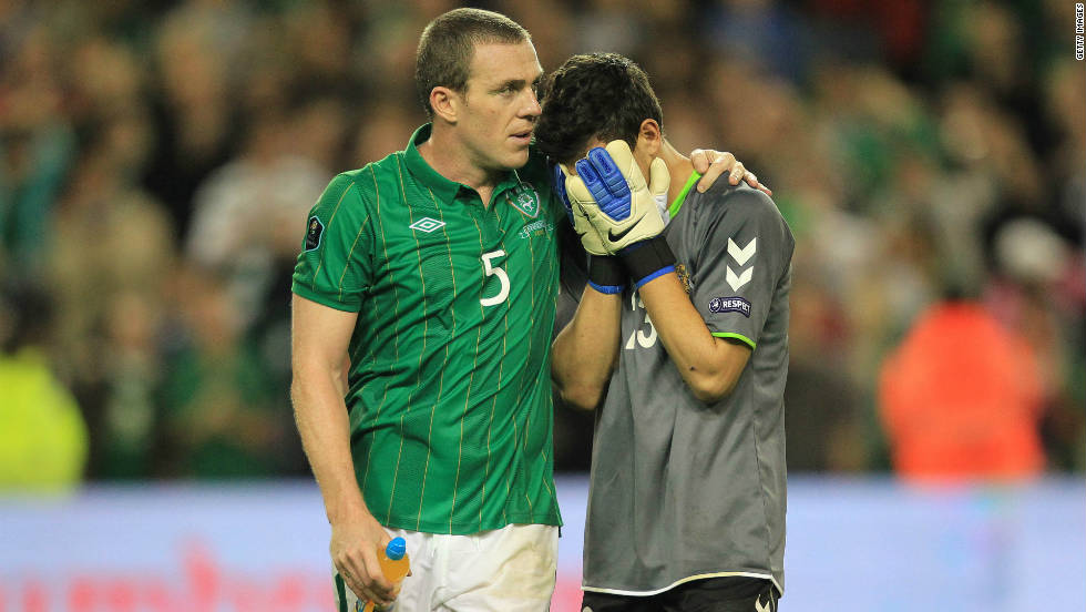 Ireland will also be seeded for the playoffs, which will take place over two legs in November, after a 2-1 victory over Armenia in a winner-takes-all match in Dublin. Defender Richard Dunne (left) scored Ireland's second and winning goal, before consoling Armenia's substitute goalkeeper Armenak Petrosyan at the final whistle.