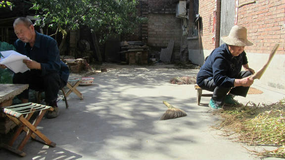 Zhang's husband (left), crushed by their son's execution, tried to commit suicide and later became half-paralyzed.