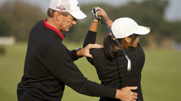 Woods spent six years with coach Hank Haney, seen here teaching a young Chinese golfer at the launch of his academy at China