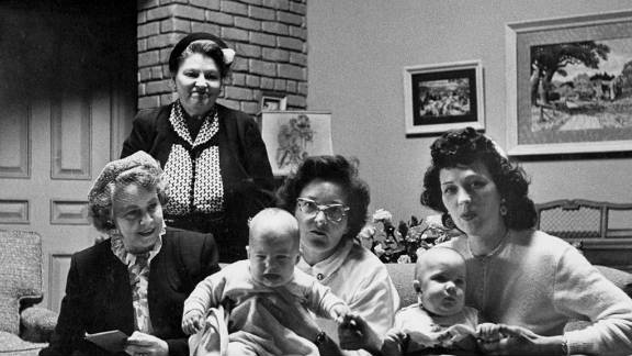 """Baby twin actors Richard and Ronald Lee sit with, from left, a social worker, their grandmother, a nurse and their mother. The episode where Lucy has a baby, """"Lucy Goes to the Hospital,"""" was watched by more people than any other program up to that time, with more than 70% of Americans watching."""