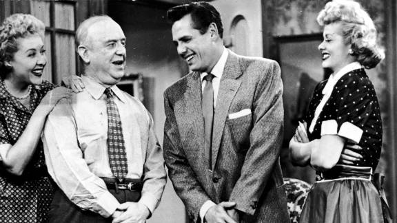 """From left, stars Vivian Vance, William Frawley, Desi Arnaz and Lucille Ball talk on the set. """"I Love Lucy"""" invented rerunning episodes when Ball became pregnant and needed rest."""