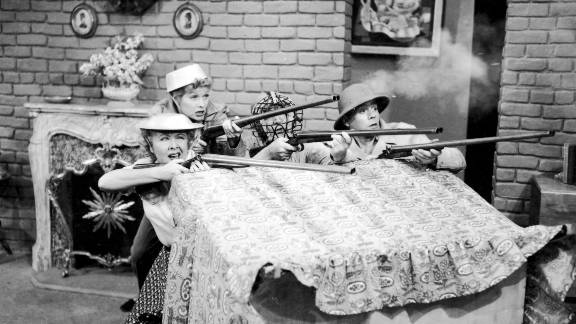 """Characters Ethel, Lucy, Fred and Ricky fight a battle in their living room in the 1952 episode """"New Neighbors."""""""