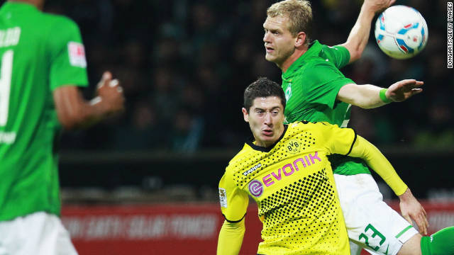 Bremen's Andreas Wolf (23) battles with Dortmund's hero and villain Ivan Perisic at Weser Stadium on Friday. .