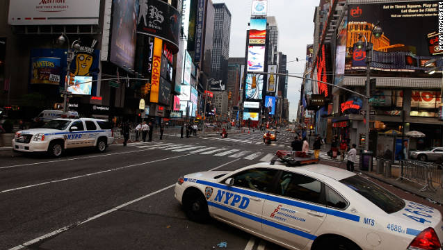Police cruisers guard where a car bomb had been parked in Times Square in May 2010.