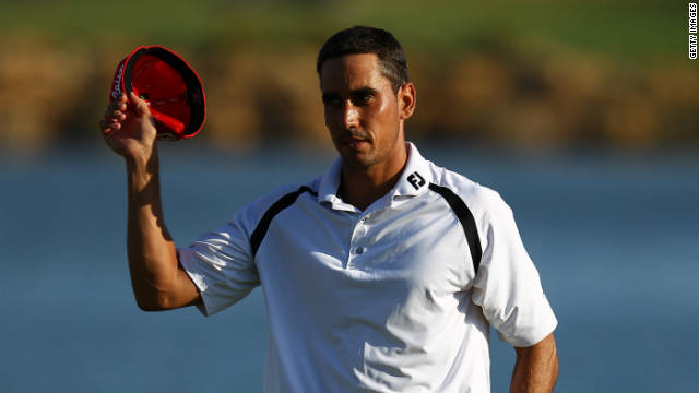 Rafael Cabrera-Bello takes the applause after finishing his round of 64 in Portugal.