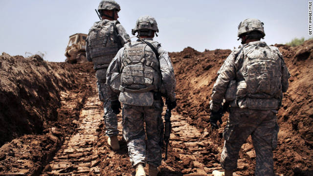 U.S. soldiers patrol a a newly dug ditch in Iraq. The country's leaders said U.S. soldiers won't receive Iraqi immunity after 2011.