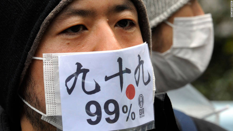 "A Japanese protestor wears a mask that says ""we are 99 percent"" during a Saturday protest in Tokyo."