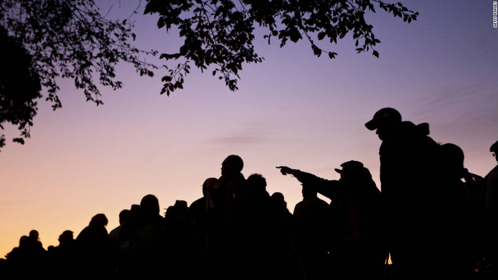 People wait in line at sunrise for the dedication ceremony at the Martin Luther King Jr. National Memorial on the National Mall in Washington on Sunday, October 16.