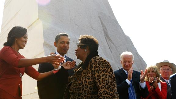 First Lady Michelle Obama reaches out to embrace Aretha Franklin as President and CEO of the Martin Luther King, Jr. National Memorial Project Foundation Harry Johnson (L), US President Barack Obama , Vice President Joe Biden (3rd R), Biden