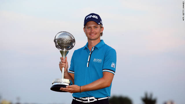 Tom Lewis proudly displays his Portugal Masters crown after victory at Vilamoura