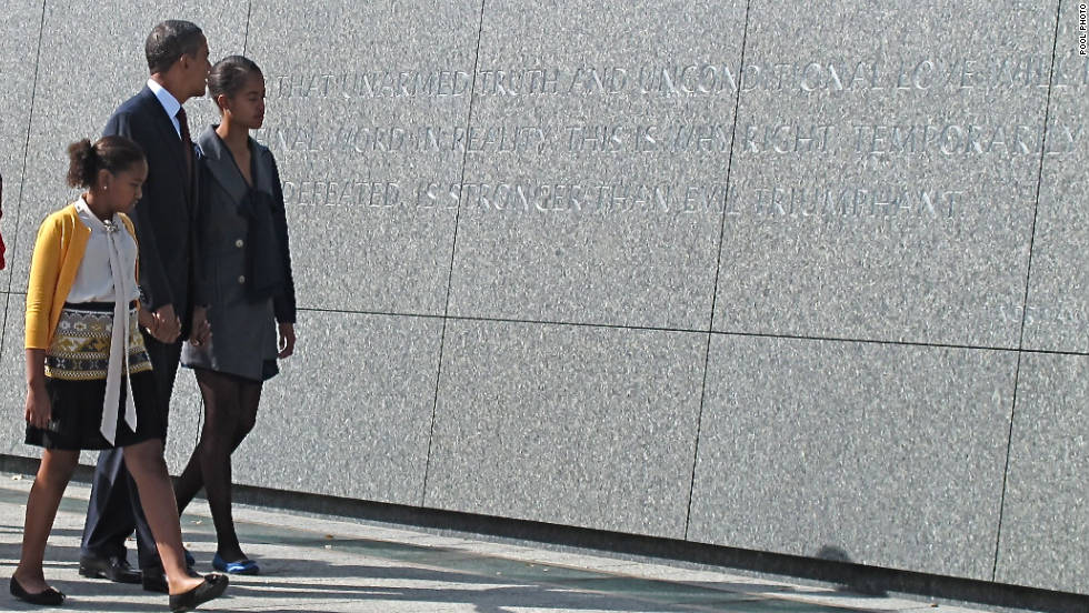 The Obama family toured the memorial before the president's speech. Obama walks with his daughters Sasha, left, and Malia.