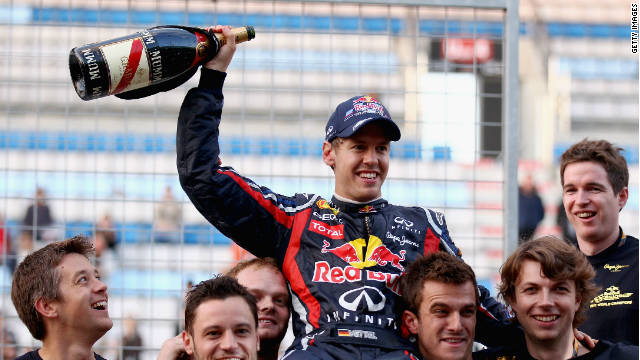 Sebastian Vettel and the Red Bull team celebrate winning the constructors' title